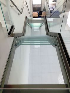 Glass Floor Panels Stair Treads for Bridge, Landings Decking: Nationwide Supply Columbus Cleveland, Ohio - Innovate Building Solutions Glass Stairs Design, Glass And Aluminium, Translucent Glass, Clear Glass, Glass Bridge, Glass Countertops, Stair Handrail, Glass Floor, Expensive Houses