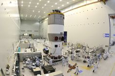 Researchers test China's first space station module Tiangong-1 inside the Jiuquan Satellite Launch Center in northwest China's Gansu Province, on the edge of the Gobi Desert. China launched the experimental module on September 29, 2011, to lay the groundwork for a future space station underscoring its ambitions to become a major space power. (AP Photo)