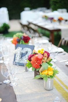 love the table numbers, love the runner, love the florals in tins!
