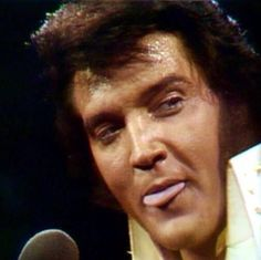 Elvis Presley with his TONGUE out of Cheek