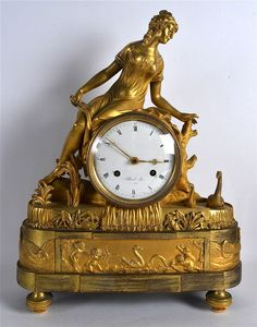 Late 18TH CENTURY FRENCH EMPIRE ORMOLU MANTEL CLOCK the dial signed Lelliard a Paris, modelled as a classical female viewing swans. 1Ft 6ins high.