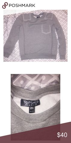 Top Shop Size 4 Authentic Grey Top Shop Pullover sweater with white stitch trim. Size 4. Like new. Topshop Sweaters