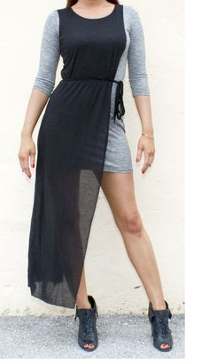 Featured item at Roc Me Out Boutique! Asymmetrical grey and black unique maxi dress. Fit and flattering!