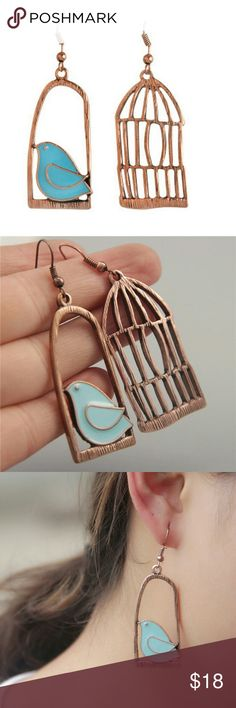 """🆕Free bird and cage earrings Brand new with tag """"Free Bird"""" and cage earrings. Super cute and unique. Antique copper plated. 2 inches long and approximately 1 inch wide. Offers Welcome! Costume jewelry Jewelry Earrings"""