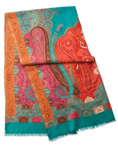 """Love this color mix. INDIAN SUMMER    De Le Cuona's Paisley throw for Barneys pays homage to the ancient textile traditions of India. Woven on handheld looms with delicate wool threads, the 39"""" x 79"""" throw costs Teal, shown, is one of three colorways. barneys.com 