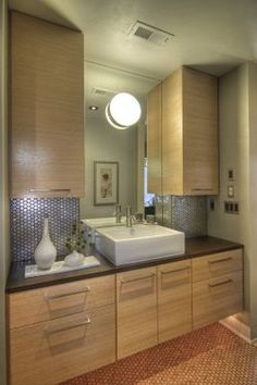 like the cupboards and sink, its good as our bathroom is small. that light is yuck though