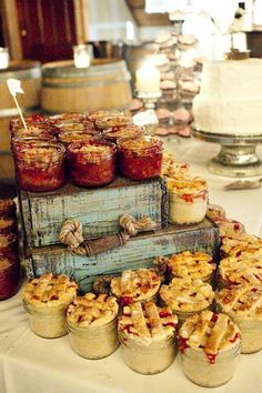 Rustic wedding dessert table with mini pies in mason jars / http://www.deerpearlflowers.com/rustic-wedding-details-and-ideas/2/