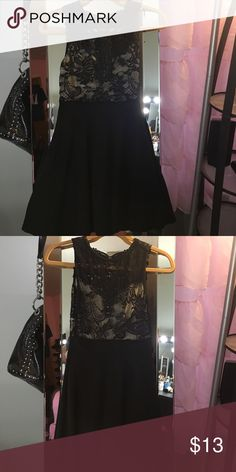 Black lace mini dress Worn once great condition fits very nice & the back is see through Joyce Leslie Dresses Mini