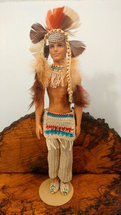 Ken is dressed as an Indian Chief. The set includes a headdress, moccasins, beaded collar, and pants. This set also includes the Ken beach doll.