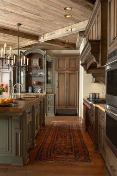 Rustic kitchen gorgeousness. #DishesOnDisplay #KitchenRug #Kitchen #Stain #Beams #Lights Hacienda Spanish #woodFloors #WoodCabinets