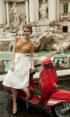 Yellow Ochre Blouse and Wedges with High Waisted White Embroidered Skirt and to top off the Outfit a Ruby Red Vespa.