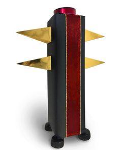 Black column wrap by John Boak. The gold pyramids once held tea-bags.