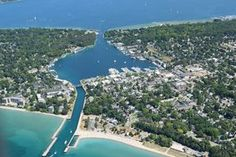 Charlevoix -- This delightful community is surrounded by water and dotted with hidden natural gems. Does it get much better than that? Weekend Trips, Vacation Trips, Vacation Spots, Day Trips, Italy Vacation, Vacation Ideas, Charlevoix Michigan, Lake Michigan, Lugares