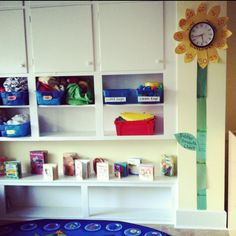 My clock in my toddler classroom! The sunflower tells the time, while the stem serves as a growth chart! :)