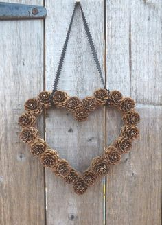DIY Pine Cone Heart - Pine Cones are a great material for wreaths. Gotta love this heart wreath for a wedding! Birch Creek Studio.