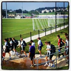 Seniors lead the JMU women's soccer team onto the practice pitch for the first time at University Park