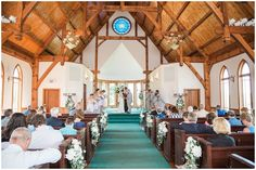bride and groom praying during ceremony in chapel at whetstone inn