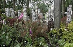 I am intrigued by the painted posts in this Show garden designed by Paul Stone of the Eden Project.  Called 'The Key', it is designed to echo the life journeys that people make.
