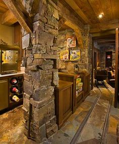 Man cave gameroom. Notice the track going down the hall - it has an old mining car on it. Guess it is to get you to bed if you drink too much in the man cave! SBC Builders, Bozeman, Montana