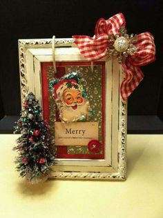 Cute idea! Framed Christmas card, hot glue bow and small tree to it.