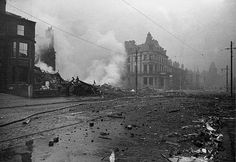 A view of Manchester's famous Oxford Road in the aftermath of a bombing raid during World War 2. A bomb appears to have destroyed several buildings very close to the centre of Manchester University.