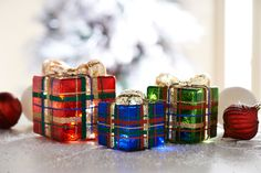 Pretty in Plaid; made of vintage glass the set of three arrive in graduated sizes and illuminate (multi color shown)  H205796 http://qvc.co/-Shop-ValerieParrHill