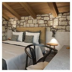 """We used raw material such as wood, stone and lava plaster that highlight the landscape interaction, the shapes' simplicity and the """"contemporary traditional"""" accommodation feeling. Exterior Design, Interior And Exterior, Unique Headboards, Jacuzzi Outdoor, Raw Material, Wood Stone, Lounge Areas, Plaster, Second Floor"""