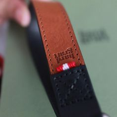 This detailed strap features two contrasting colours and attaches firmly to your wrist.