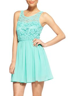 AUDREY PARTY DRESS Spring's looking pretty with this playful frock. For daytime cute or nighttime chic, go all out girly with this sleek style. Lace bodice with cinched waist and free flowing skirt. 100% polyester.