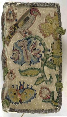 Embroidered book cover, bird, bugs, flowers.