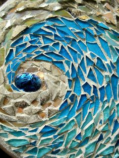 Sand and Sea Mosaic Mandala ©Margaret Almon A challenge to use beach colors, with glass tile, silver and copper smalti, stained glass, mother of pearl, and abalone shell center, on wood, 8""