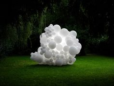 White balloons spill out the windows and doors of a house, invade a golf course and overflow from a burnt-out car in a series of installations by French artist Charles Pétillon (+ slideshow).