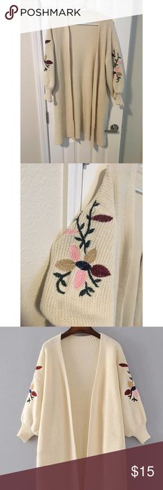 Oversized Sweater with Floral Embroidery Cream colored oversized sweater with drop shoulder and floral embroidery on the sleeves  Has pockets One Size but fits M/L if you really like oversized sweaters it would fit a S too Sweaters Cardigans