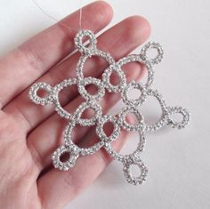 Silver Christmas tree decoration in tatting