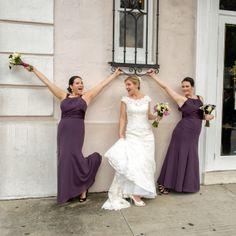 Braidsmaids in purple dress, lace wedding dress, white and purple flowers.