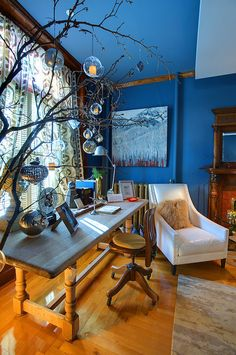 Blond wood, blue walls. Dig the tree branch, too