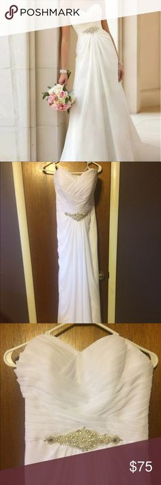 Nwot strapless wedding dress Nwot white strapless wedding dress. Beaded accent on bodice. Corset back. Dresses Wedding