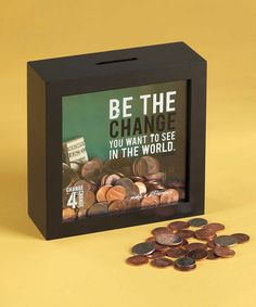 Shadow box with a slit cut in the top, cute quotes painted on the front, and ta-da! instant adorable bank.   Be the Change Bank by Jozie B