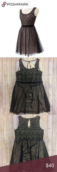 """LC Lauren Conrad Lace Dreamer Tulle Dress XL NWT Item Specifics Brand: LC Lauren Conrad  Silouhette: Empire Waist Princess Color: Black & Pink Size: US Size XL Orig Price: $64  Measurements in Inches (when laid flat) Waist: 19"""" (untied) Armpit to armpit chest: 21"""" Sweep: 33"""" Length: 37.5""""  Garment Details Elastic Waist: No Hidden Zipper: No New With Tags: Yes Lined: Yes Features: Empire Waist  Adjustable Tie-Backs Materials: Upper Body 62% Cotton, 38% Polyester  Lining & Lower Body 100%…"""