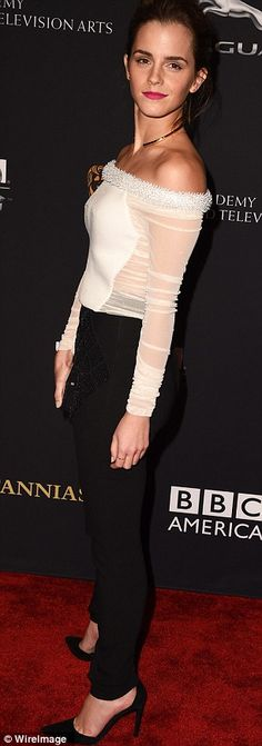 Monochrome madness: Emma donned a off-the-shoulder top tucked into black trousers and black leather heels