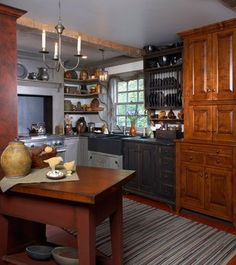 Affix solid wood beams to the ceiling to give a kitchen of any age an old-fashioned country primitive feel .