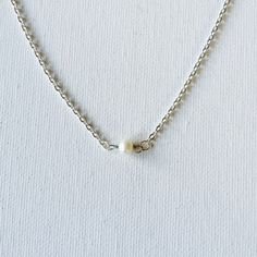 Made a freshwater pearl silver floating necklace!