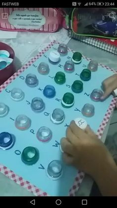 Lower case letters on lids, uppercase aboveFor learning how to count up t Preschool Learning Activities, Alphabet Activities, Infant Activities, Preschool Activities, Teaching Kids, Kids Learning, Kids Education, Motor Skills, Fine Motor