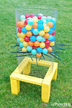 Giant outdoor Kerplunk game with water balloons! 32 Fun DIY Backyard Games To Play (for kids & adults!)