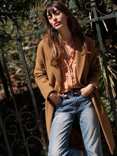 madewell atlas cocoon coat worn with the silk ruffle blouse + flatform collar necklace.
