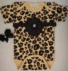 Cheetah leopard print baby girl onesie body suit with snap on flower on Etsy, $19.95----if I have a little girl, I WILL get this for her!