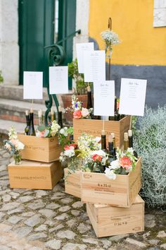 Rustic Crate Table plan | Destination Wedding in Portugal | Rustic Ceremony & Reception | Floral Arches & Hanging Greenery Decor | Essence of Australia Fishtail Gown | Anneli Marinovich Photography | http://www.rockmywedding.co.uk/dominique-phil/