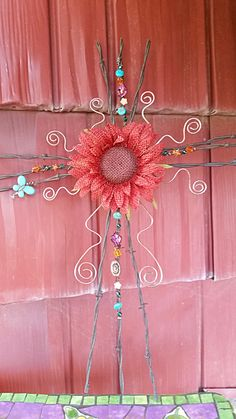 $40 - barb wire cross with burlap sunflower, turquoise butterfly, crystals and copper squigglies