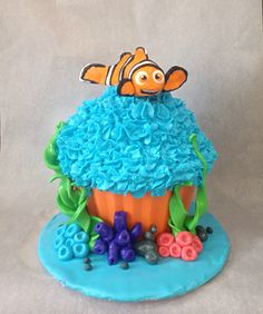 """""""Finding Nemo"""" giant cupcake. Made this for a one year old boy as the smash-cake for his photo shoot. It was a lot of fun!"""