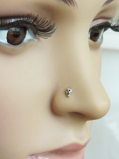 Hey, I found this really awesome Etsy listing at http://www.etsy.com/listing/150149924/mini-skull-nose-stud-l-bend